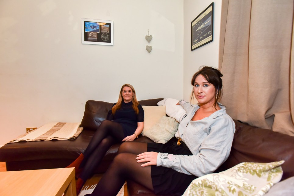 Lauren and Sarah sitting on a sofa in the three bedroom house in Highbury