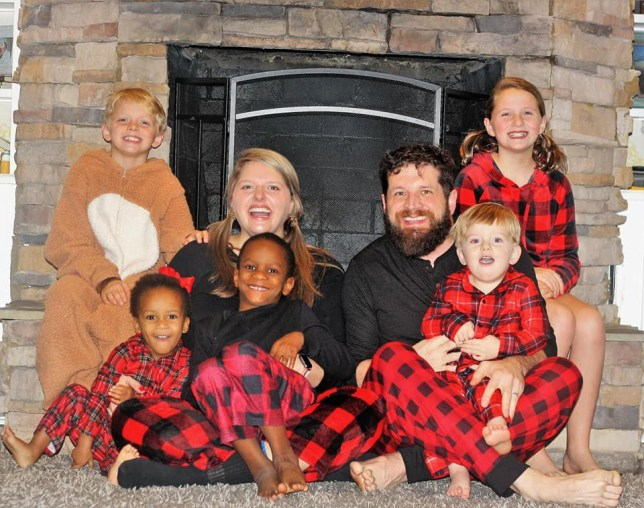 Parenting blogger Stephanie Hollifield is seen with husband AJ Hollifield and their children in AJ's Facebook cover photo.