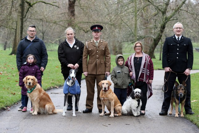 The finalists for the prestigious Crufts dog hero competition, Friends for Life 2019, (left to right) Steve Gunn, his daughter Milli and their dog Emma, Sarah Candy and her dog Ringo, Private Lee Hampson and his dog Lance, Becky Gaye, her son Oli, and their dog Snoopy, and PC David Wardell and his dog Finnattend a launch event for this year's Crufts and the Friends for Life dog hero finalists at the Kennel Club in London. PRESS ASSOCIATION Photo. Picture date: Tuesday February 5, 2019. See PA story ANIMALS Crufts. Photo credit should read: Jonathan Brady/PA Wire