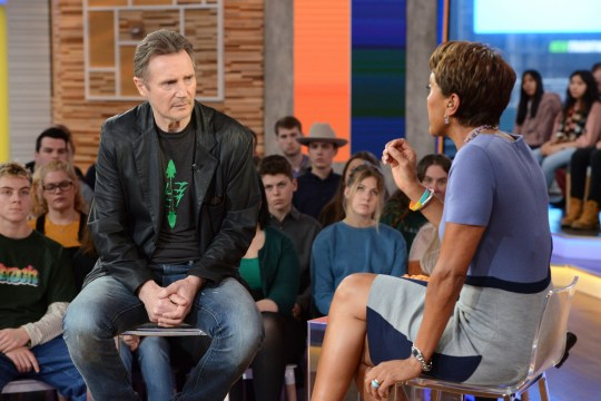 "This image released by ABC shows Irish actor Liam Neeson, left, with co-host Robin Roberts on ""Good Morning America,"" Tuesday, Feb. 5, 2019, in New York. The 66-year-old actor appeared on the morning program one day after he told an interviewer that he had violent thoughts about killing a black person after learning nearly 40 years ago that someone close to him had been raped. Neeson says he's not a racist. The actor, who was promoting the revenge film ""Cold Pursuit,"" says we need to talk about these things because bigotry and racism exist. (Lorenzo Bevilaqua/ABC via AP)"