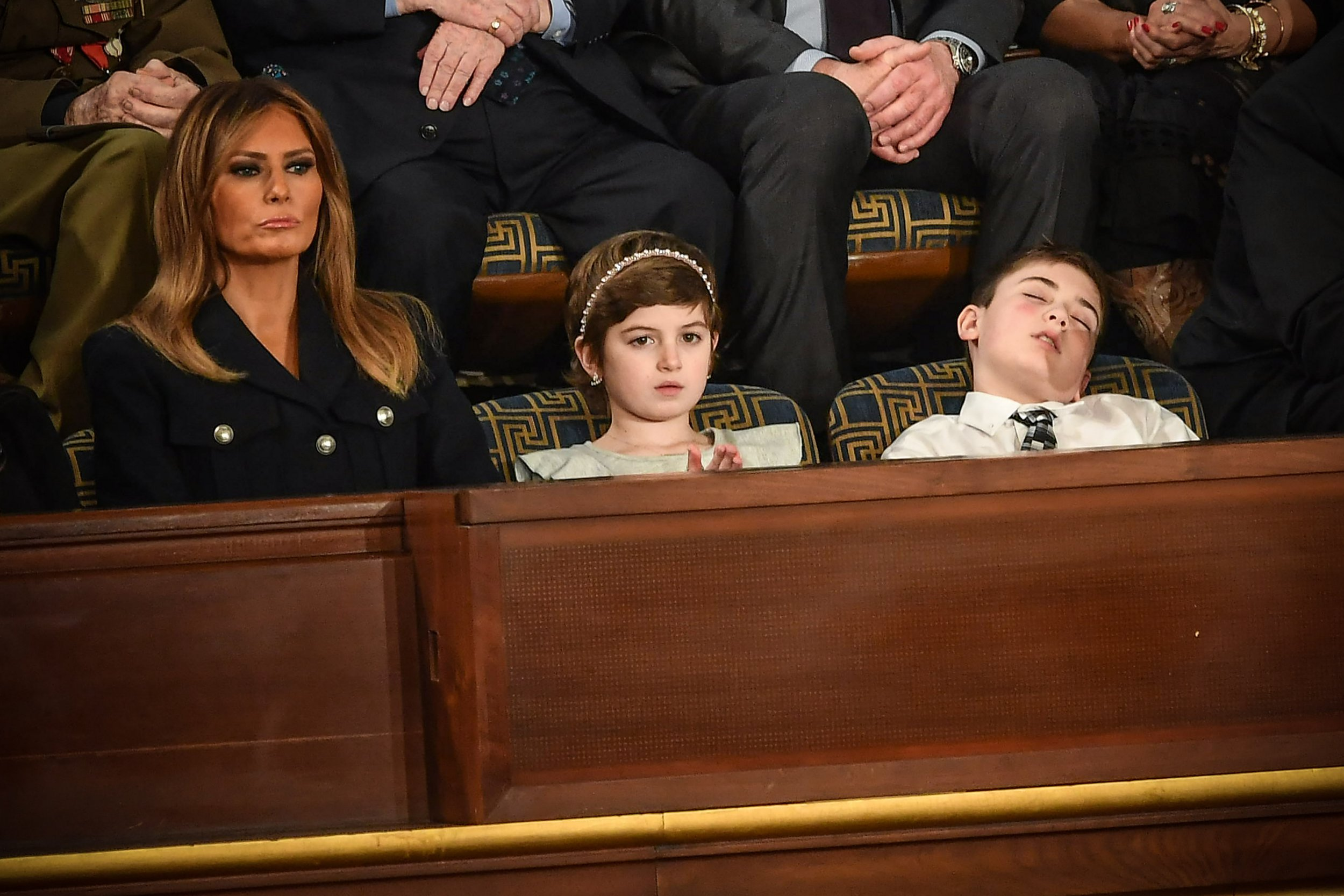 US First lady Melania Trump (L) with Grace Eline and Joshua Trump, special guests of President Donald Trump, look during of the State of the Union address at the US Capitol on February 5, 2019 in Washington, DC. (Photo by MANDEL NGAN / AFP)MANDEL NGAN/AFP/Getty Images