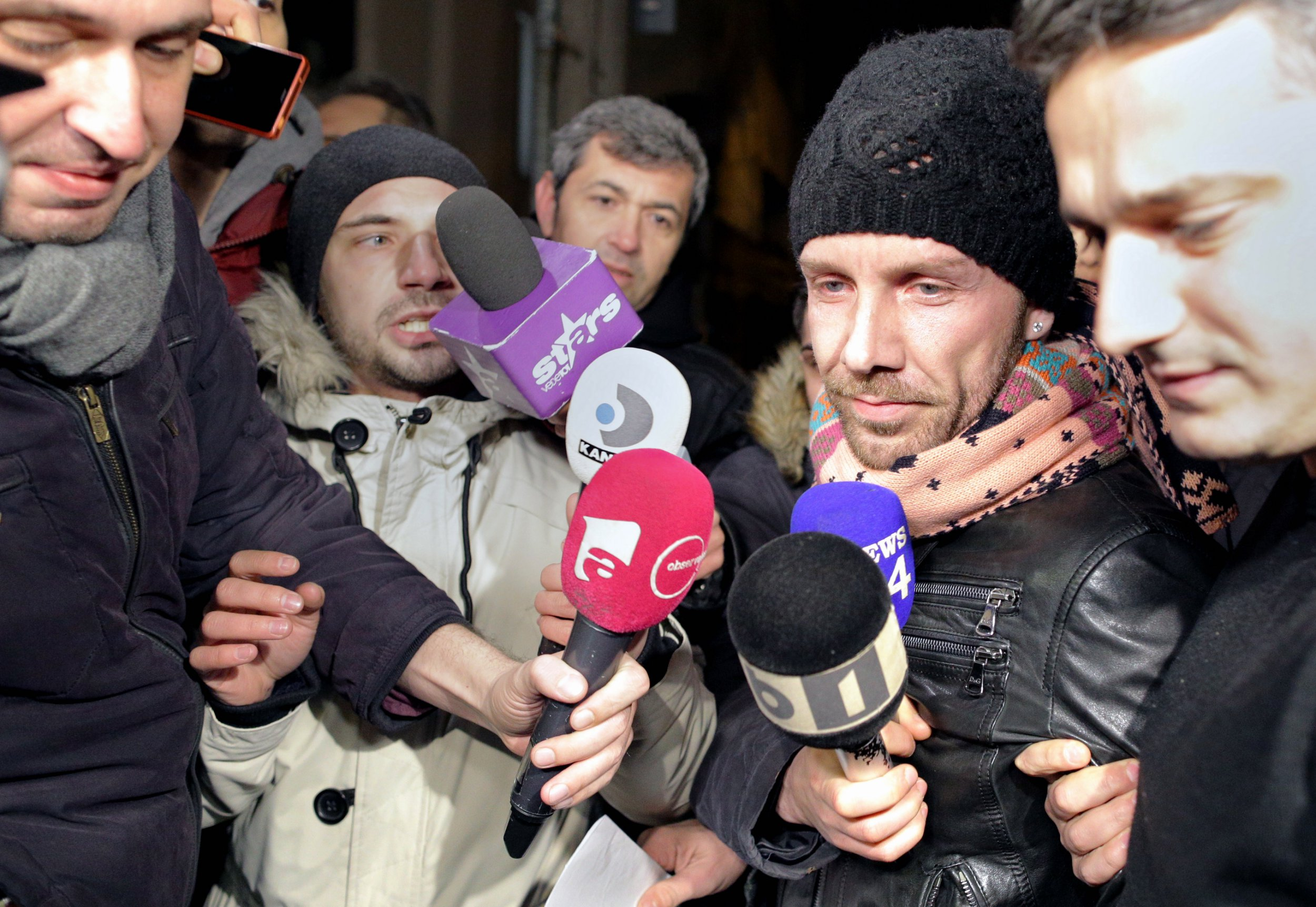 epa07348650 Italian man Matteo Politi (2-nd R), 38, who allegedly posed as a plastic surgeon, is surrounded by TV journalists while being escorted by a Romanian policemen (R) towards the Police Station No. 4 after being arrested for further investigations, in Bucharest, Romania, 06 February 2019. Politi, who posed as a famous plastic surgeon and performed surgeries on patients at few private clinics in Romania's capital despite having no medical training and legal license, was caught by border police while trying to leave Romania by train. 'Libertatea' newspaper reported that a nurse became suspicious as the man do not use proper procedures for hand washing and glove wearing prior to surgery operations, and due to the longer time he needed to perform a breast implant. Italian media reported that Politi was convicted in 2011 for a similar fraud, receiving a 18 month sentence with suspension. There are no reports yet of patients suffering as a result of Politi surgeries. EPA/VLAD CHIREA