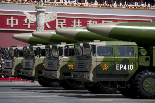 BEIJING, CHINA - SEPTEMBER 03: Military vehicles carrying DF-26 ballistic missiles, drive past the Tiananmen Gate during a military parade to mark the 70th anniversary of the end of World War Two on September 3, 2015 in Beijing, China. China is marking the 70th anniversary of the end of World War II and its role in defeating Japan with a new national holiday and a military parade in Beijing. (Photo by Andy Wong - Pool /Getty Images)