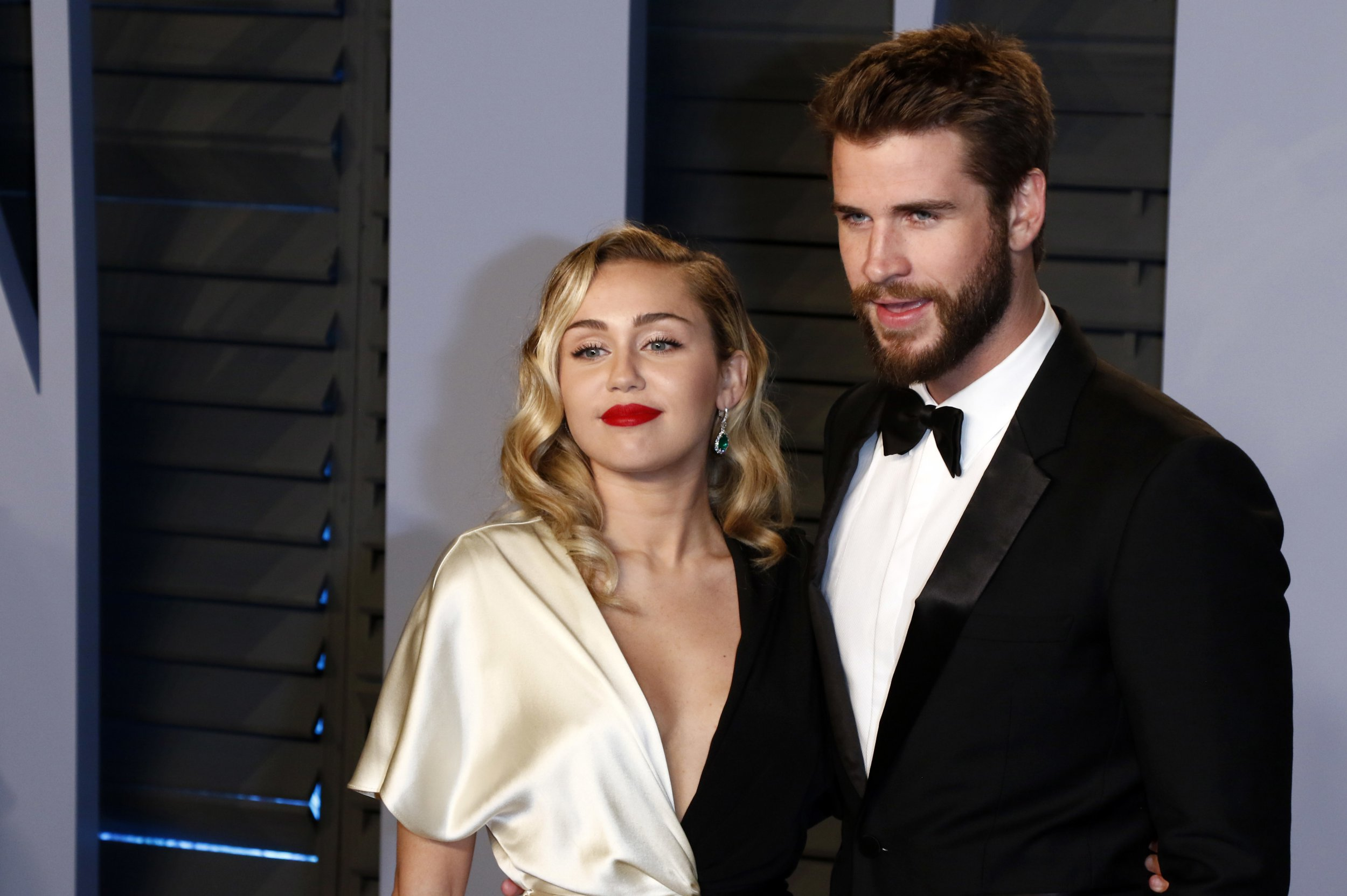 Miley Cyrus shares new photos from her wedding day in a Valentine's Day tribute to Liam Hemsworth