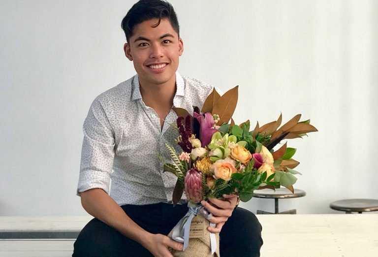 Man discovers flowers he picked up from his desk on his first day were never meant for him