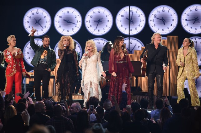 US singer Katy Perry (L), Karen Fairchild, Kimberly Schlapman, Phillip Sweet, and Jimi Westbrook of US country group Little Big Town, US singers Dolly Parton (C) and Miley Cyrus (R) perform onstage during the 61st Annual Grammy Awards on February 10, 2019, in Los Angeles. (Photo by Robyn BECK / AFP)ROBYN BECK/AFP/Getty Images