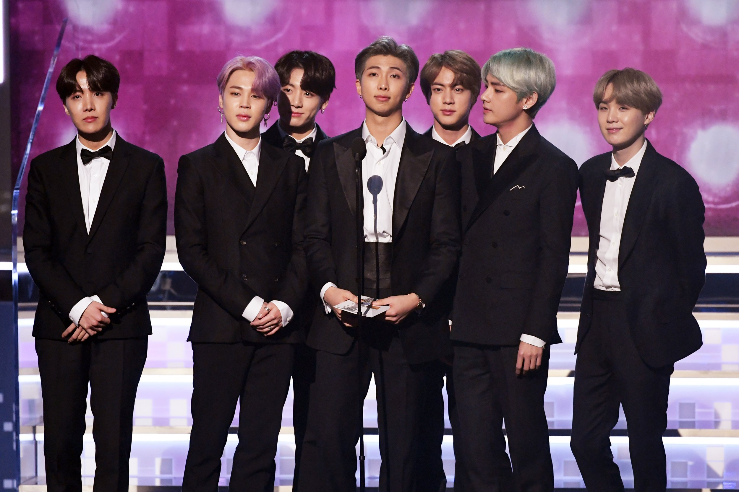 LOS ANGELES, CA - FEBRUARY 10: RM (C) and fellow BTS members speak onstage during the 61st Annual GRAMMY Awards at Staples Center on February 10, 2019 in Los Angeles, California. (Photo by Kevin Winter/Getty Images for The Recording Academy)