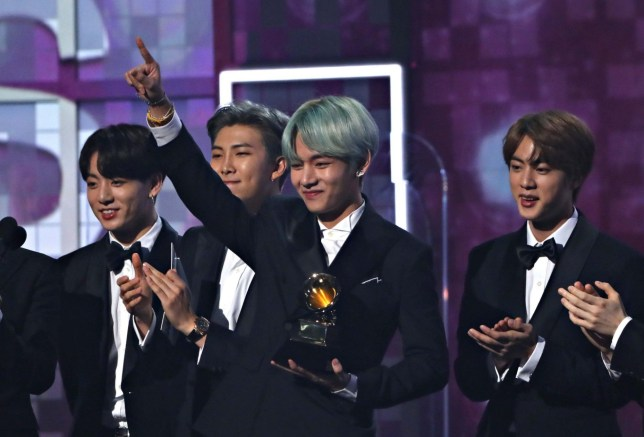 61st Grammy Awards - Show - Los Angeles, California, U.S., February 10, 2019 - South Korean boy band BTS present Best R& B Album to H.E.R. REUTERS/Mike Blake