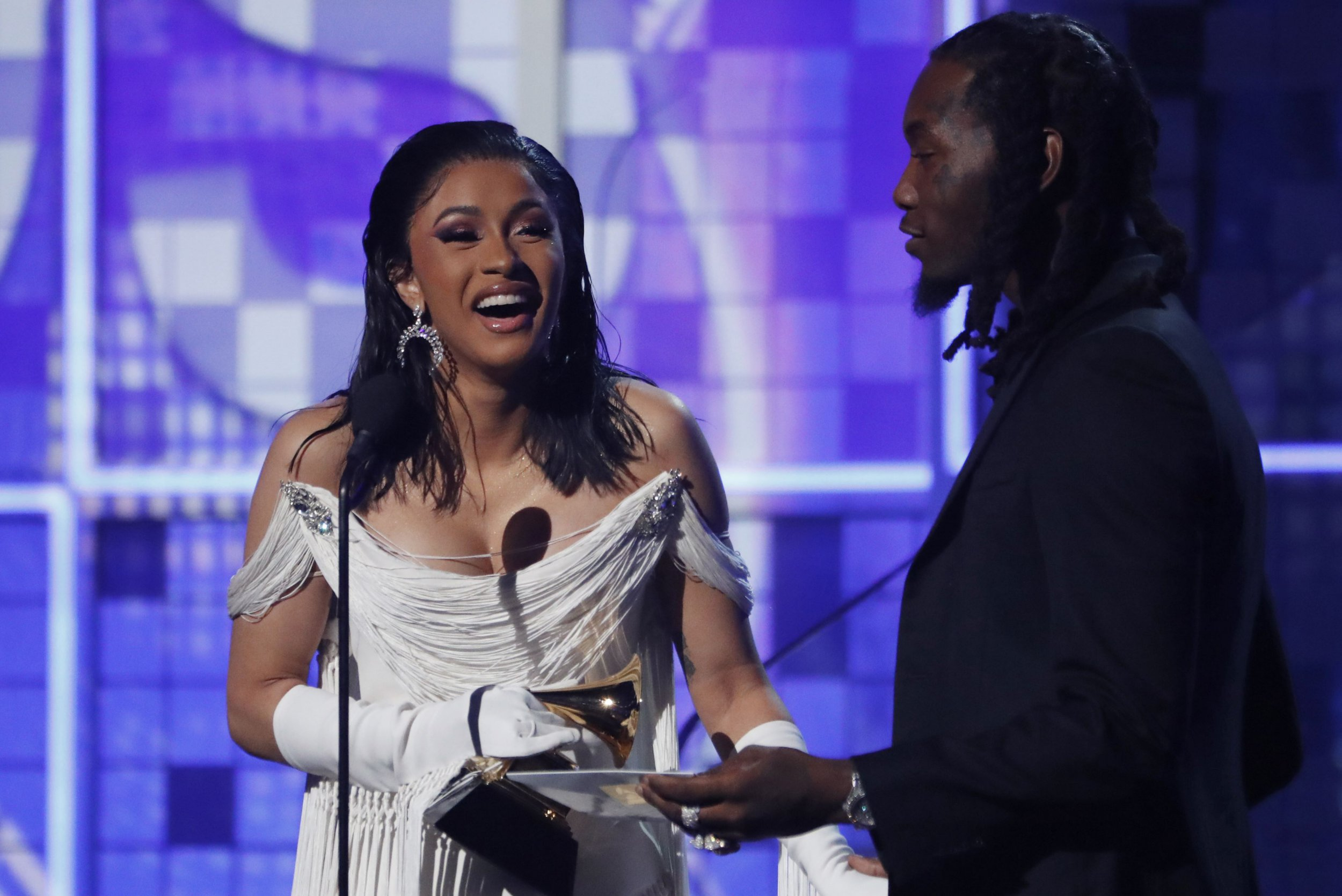 "61st Grammy Awards - Show - Los Angeles, California, U.S., February 10, 2019 - Cardi B accepts the Best Rap Album award for ""Invasion of Privacy"" next to her husband Offset. REUTERS/Mike Blake"