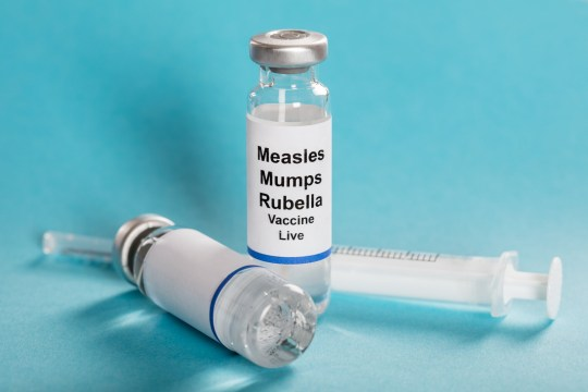 Measles Mumps Rubella Vaccine Vials With Syringe Over Turquoise Background