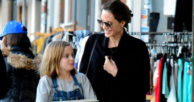 PREMIUM EXCLUSIVE Please contact X17 before any use of these exclusive photos - x17@x17agency.com Monday, February 11, 2019 - Angelina Jolie looks ecstatic while taking daughter Vivienne out toy shopping in Larchmont Village after Brad Pitt was spotted attending ex Jennifer Aniston's 50th birthday over the weekend. Apparently Angelina is totally unfazed by her ex hubby getting close to his first wife again! - Luis/X17online.com