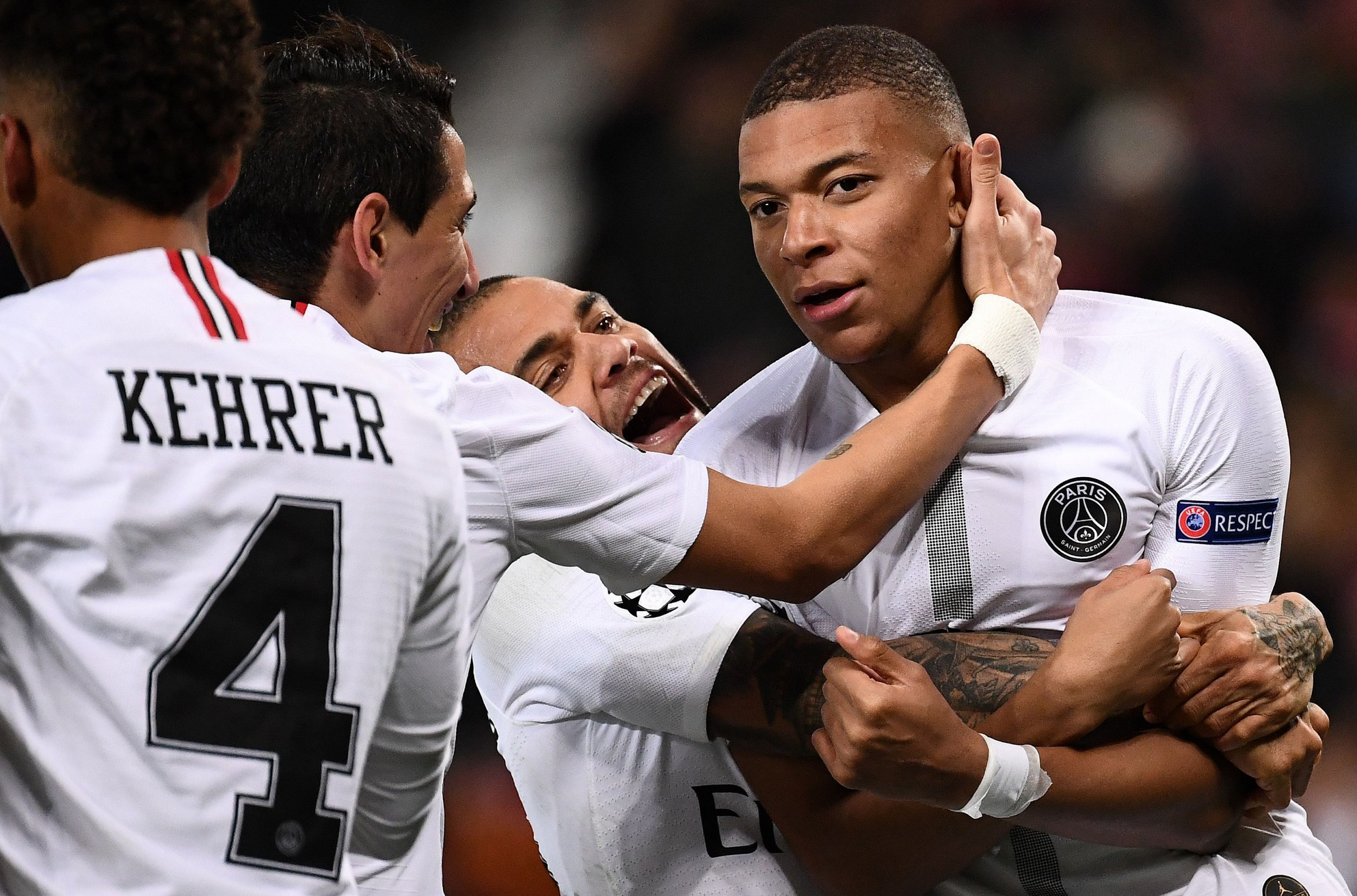 Paris Saint-Germain's French striker Kylian Mbappe (R) celebrates scoring his team's second goal during the first leg of the UEFA Champions League round of 16 football match between Manchester United and Paris Saint-Germain (PSG) at Old Trafford in Manchester, north-west England on February 12, 2019. (Photo by FRANCK FIFE / AFP)FRANCK FIFE/AFP/Getty Images
