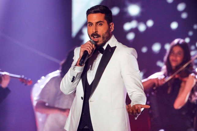 "Israeli singer Kobi Marimi performs during the reality TV show ""The Next Star for Eurovision"" in Neve Ilan, west of Jerusalem late on February 12, 2019. - Marimi was announced as the country's representative to the Eurovision Song Contest after winning in the TV show. (Photo by MENAHEM KAHANA / AFP)MENAHEM KAHANA/AFP/Getty Images"