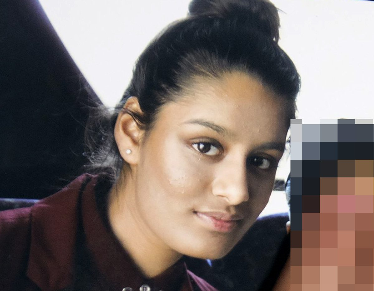 EDITORS NOTE: FACE IN PHOTO BEING HELD DELIBERATELY COVERED BY SISTER Renu, eldest sister of Shamima Begum, 15, holds her sister's photo while being interviewed by the media at New Scotland Yard, central London, as the relatives of three missing schoolgirls believed to have fled to Syria to join Islamic State have pleaded for them to return home.