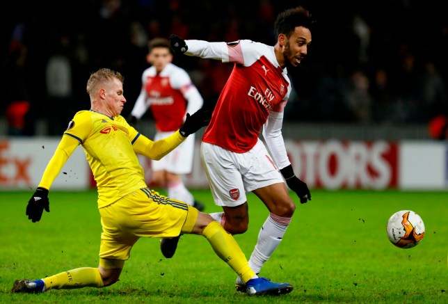 BARYSAW, BELARUS - FEBRUARY 14: Pierre-Emerick Aubameyang (R) of Arsenal and Evgeni Berezkin of BATE Borisov vie for the ball during the UEFA Europa League Round of 32 First Leg match between BATE Borisov and Arsenal at Borisov-Arena on February 14, 2019 in Borisov, Belarus. (Photo by MB Media/Getty Images)