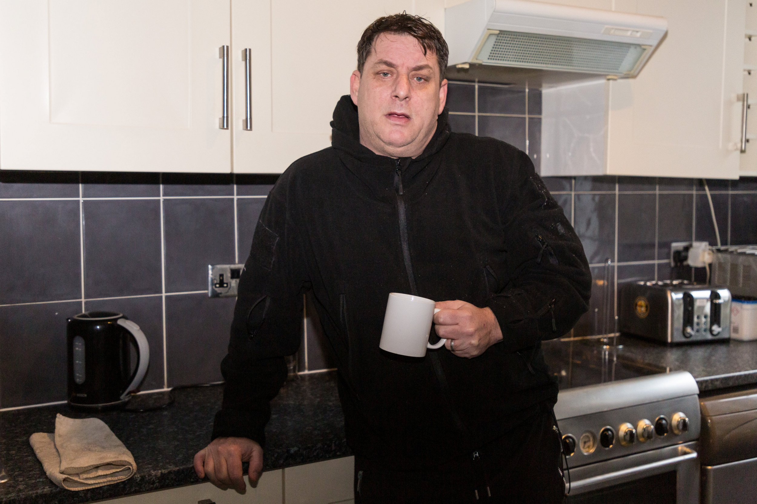 Antony Zomparelli in his Georgian flat he bought through Right-To-Buy in 2014. See SWNS story SWSYflat; A homeowner has been told to pay ??360,000 or face losing his home after the council mistakenly sold him a ??700,000 flat -- at half price. Antony Zomparelli, 54, bought his two-bed flat from Islington Borough Council for ??340,000 in 2014. But two years later the council wrote to the security guard, admitting they had accidentally undercharged him because they thought the home only had one bedroom. Dad-of-four Antony was unable to fork out the difference - so the council is taking him to court to reclaim ownership of his flat or the money they claim he owes.