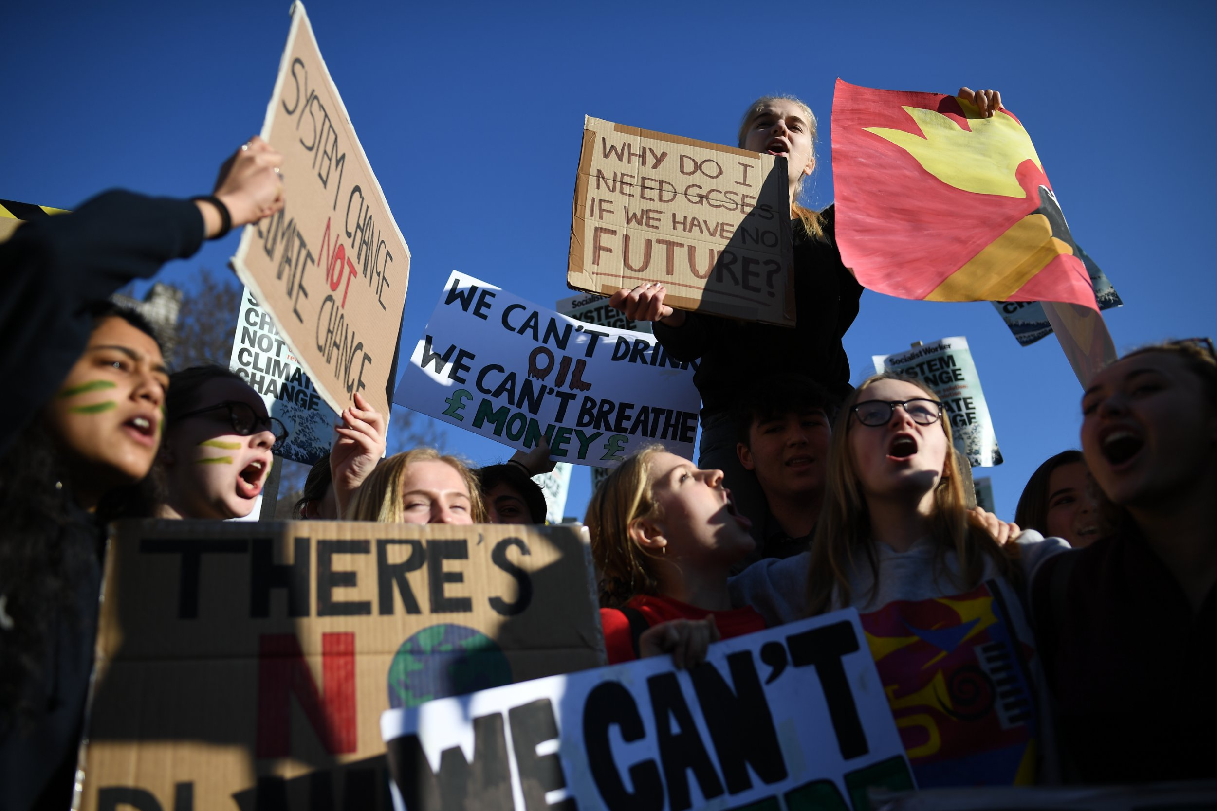 Schoolchildren take part in a student climate march in Parliament Square
