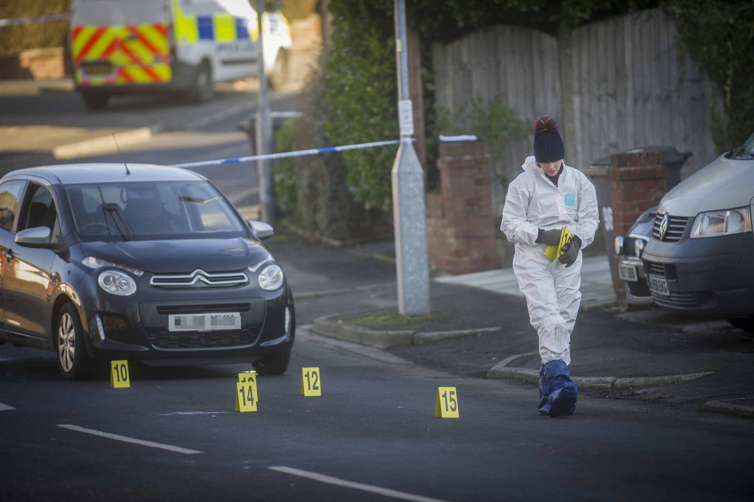 Police scene on Nook Lane Ashton Man fighting for life after being run down as he tried to stop car thieves - police are urgently trying to find vehicle
