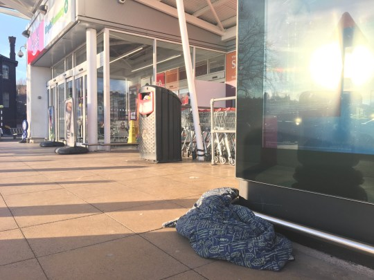 Police are warning about growing numbers of beggars pretending to be homeless outside a town centre supermarket - and are urging shoppers not to give them any money. Begging outside Sainsbury's, in Stoke, has increased in recent weeks despite charities offering them support and hostels accepting more people. Shoppers have reported being 'intimidated' by people demanding money outside the London Road store. The situation was raised at this month's meeting of the police and communities together (PACT) group which covers Stoke, Penkhull, Hartshill and Basford. Staffordshire Police have warned members of the public about people outside Sainsbury's in London Road, Stoke begging who aren't homeless. A blanket left outside Sainsbury's on Thursday afternoon.