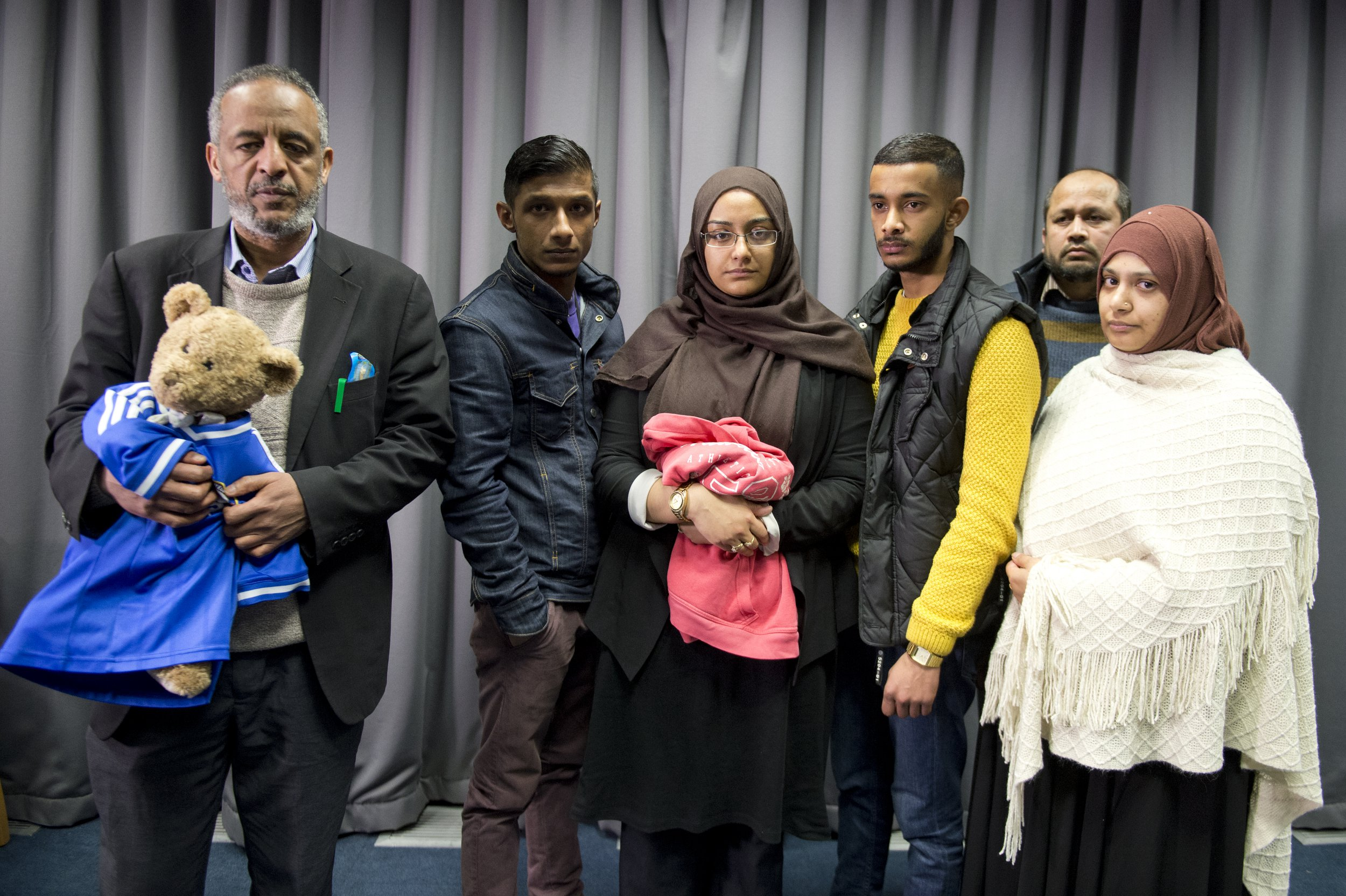 LONDON, ENGLAND - FEBRUARY 22: The famiiles of Amira Abase and Shamima Begum, the three missing schoolgirls believed to have fled to Syria to join Islamic State, pose after being interviewed by the media at New Scotland Yard, after pleading for them to return home, on February 22, 2015 in London, England. Police are urgently trying to trace Shamima Begum, 15, Kadiza Sultana, 16, and 15-year-old Amira Abase after they flew to Istanbul in Turkey from Gatwick Airport on Tuesday. (Photo by Laura Lean - WPA Pool/Getty Images)