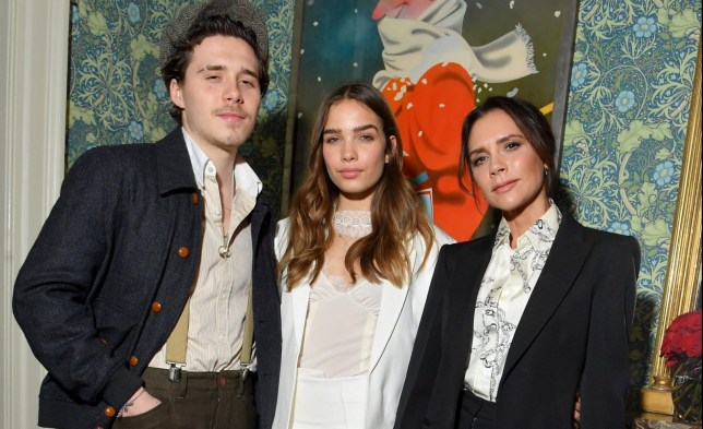 LONDON, ENGLAND - FEBRUARY 17: (L-R) Brooklyn Beckham, Hana Cross and Victoria Beckham attend the Victoria Beckham x YouTube Fashion & Beauty After Party at London Fashion Week hosted by Derek Blasberg and David Beckham, at Marks Club on February 17, 2019 in London, England. (Photo by Victor Boyko/Getty Images for YouTube)