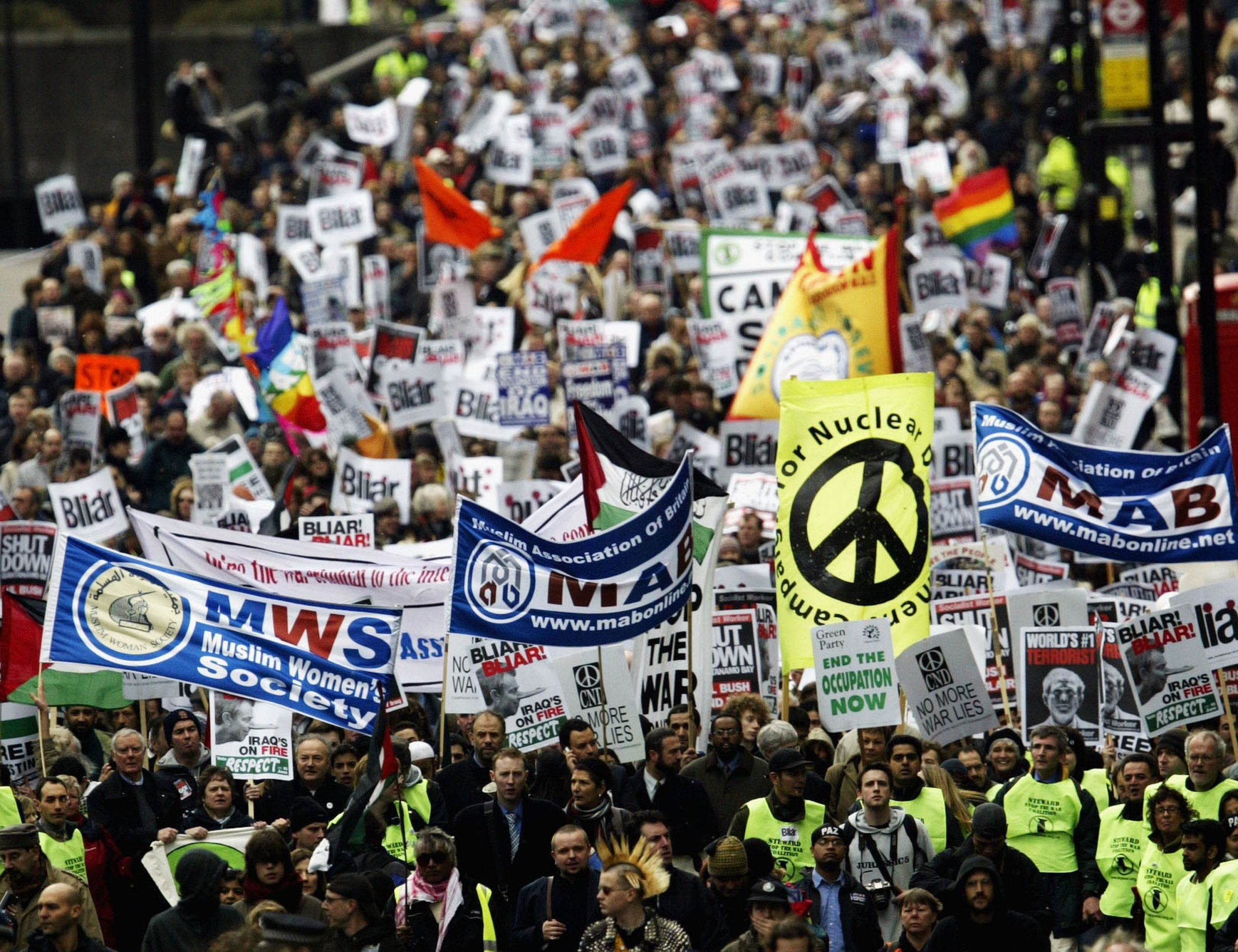 LONDON - MARCH 20: Anti-war demonstrators gather to mark the anniversary of the Iraq War March 20, 2004 in London. A march from Hyde Park to Trafalgar Square was held to protest again war in Iraq. (Photo by Graeme Robertson/Getty Images) *** Local Caption ***