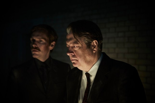 MAMMOTH SCREEN FOR ITV ENDEAVOUR EPISODE 2 2019 Pictured: SHAUN EVANS as Endeavour and ROGER ALLAM as DI Fred Thursday. This photograph must not be syndicated to any other company, publication or website, or permanently archived, without the express written permission of ITV Picture Desk. Full Terms and conditions are available on www.itv.com/presscentre/itvpictures/terms For further information please contact: Patrick.smith@itv.com 0207 1573044