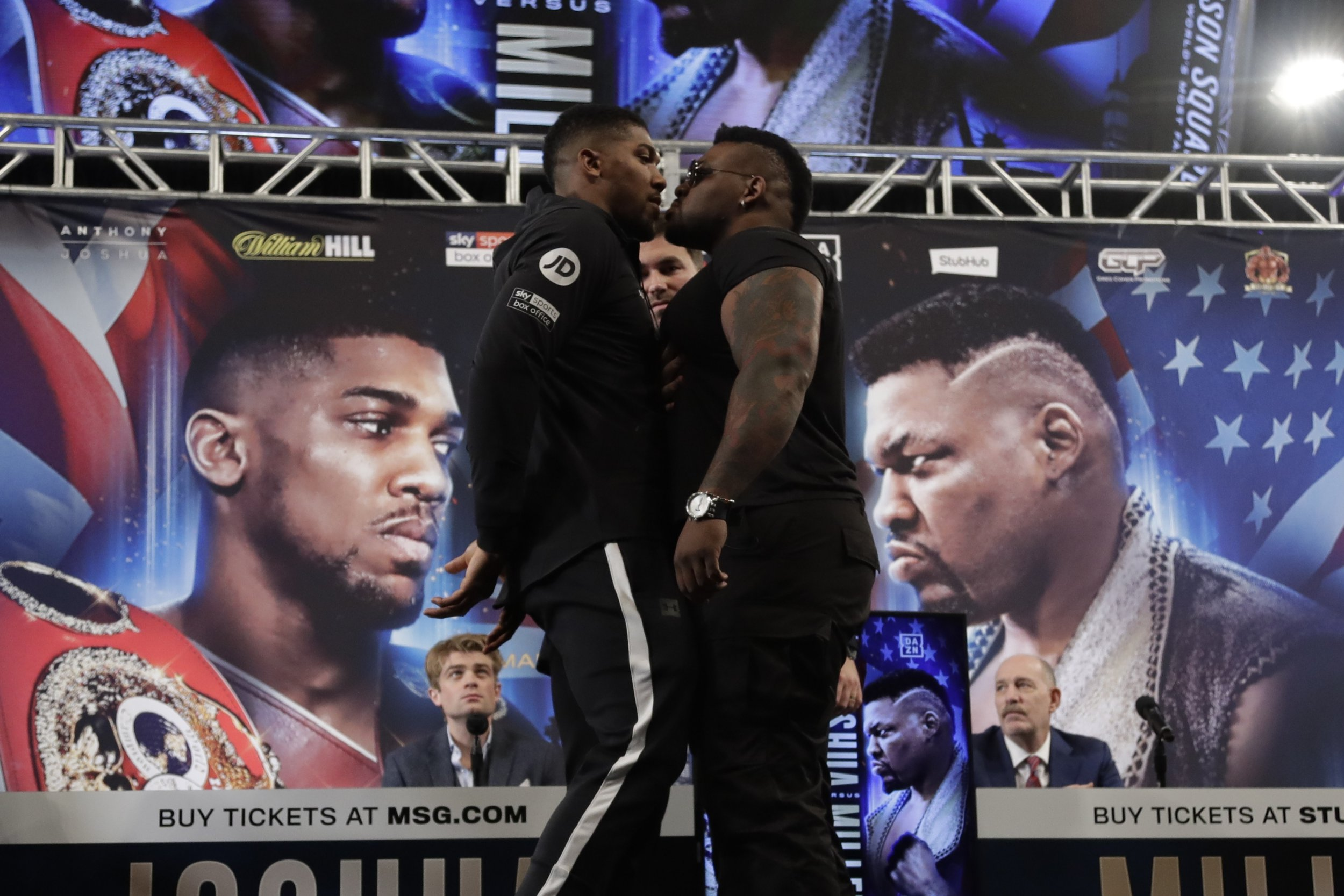 British boxer Anthony Joshua, left, and Jarrell Miller, right, pose for photographs during a news conference to promote their upcoming fight, Tuesday, Feb. 19, 2019, in New York. (AP Photo/Frank Franklin II)