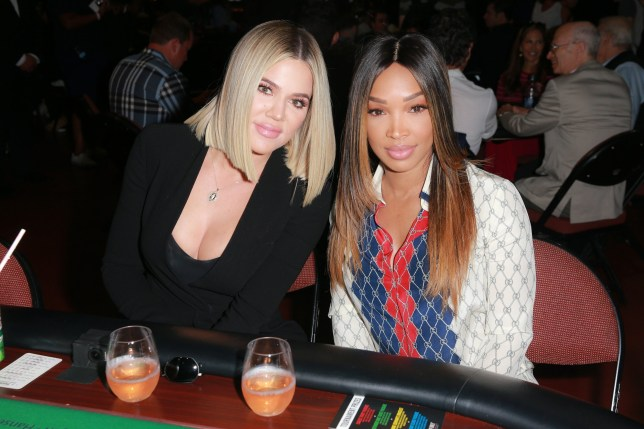 """INGLEWOOD, CA - JULY 29: Khloe Kardashian (L) and Malika Haqq attend the first annual """"If Only"""" Texas hold'em charity poker tournament benefiting City of Hope at The Forum on July 29, 2018 in Inglewood, California. (Photo by Rich Fury/Getty Images)"""