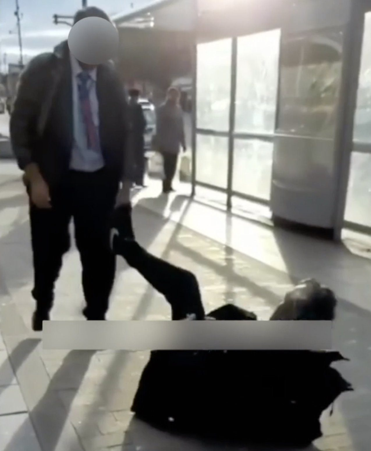 A schoolboy stands over an older man as they engage in a bizarre fight on the streets of Southall, London, February, 2019. A SHOCKING video has surfaced online showing a schoolboy PUSH a vulnerable old man to the ground on a busy street in Southall, London. In the clip, the schoolboy and elderly male engage in a bizarre fight as the teen?s laughing friends encourage the young assailant to ?Bang him up!?. The old man tries to get away from the teenagers. But in a shocking twist, the schoolboy shoves the feeble pensioner so he tumbles and rolls across the pavement. Social media users have condemned the appalling incident, which is believed to have taken place in South Road in Southall earlier this month. The video appears to have been filmed by the young assailant?s accomplices. The footage was originally posted on Instagram page @ub1ub2 but has since been deleted. ... SEE COPY AND VID ... PIC BY NEWS DOG MEDIA ... 0121 517 0019