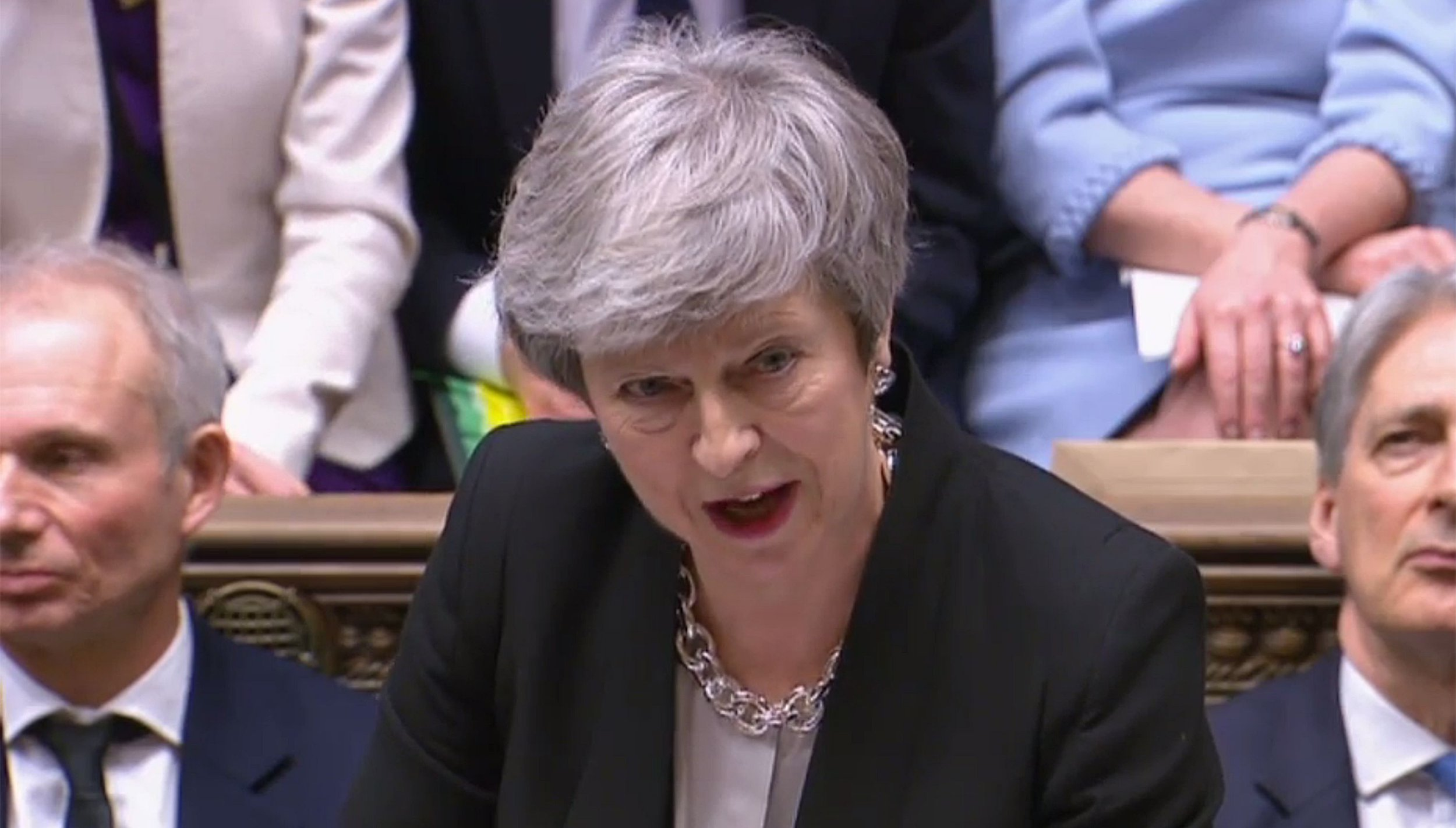 "A video grab from footage broadcast by the UK Parliament's Parliamentary Recording Unit (PRU) shows Britain's Prime Minister Theresa May as she speaks during the weekly Prime Minister's Questions (PMQs) in the House of Commons in London on February 13, 2019. - The British government denied Wednesday it was secretly plotting to bounce MPs into a last-minute choice just days before Brexit between a rejigged deal or a lengthy delay. ITV television reported that it had overheard Prime Minister Theresa May's chief Brexit negotiator Olly Robbins in a Brussels bar saying the European Union would probably let Britain extend its March 29 departure date. (Photo by - / PRU / AFP) / RESTRICTED TO EDITORIAL USE - MANDATORY CREDIT "" AFP PHOTO / PRU "" - NO USE FOR ENTERTAINMENT, SATIRICAL, MARKETING OR ADVERTISING CAMPAIGNS-/AFP/Getty Images"