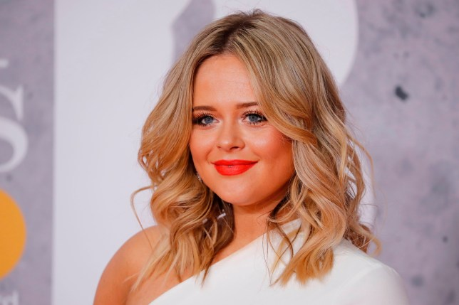 British actor Emily Atack poses on the red carpet on arrival for the BRIT Awards 2019 in London on February 20, 2019. (Photo by Tolga AKMEN / AFP) / RESTRICTED TO EDITORIAL USE NO POSTERS NO MERCHANDISE NO USE IN PUBLICATIONS DEVOTED TO ARTISTSTOLGA AKMEN/AFP/Getty Images