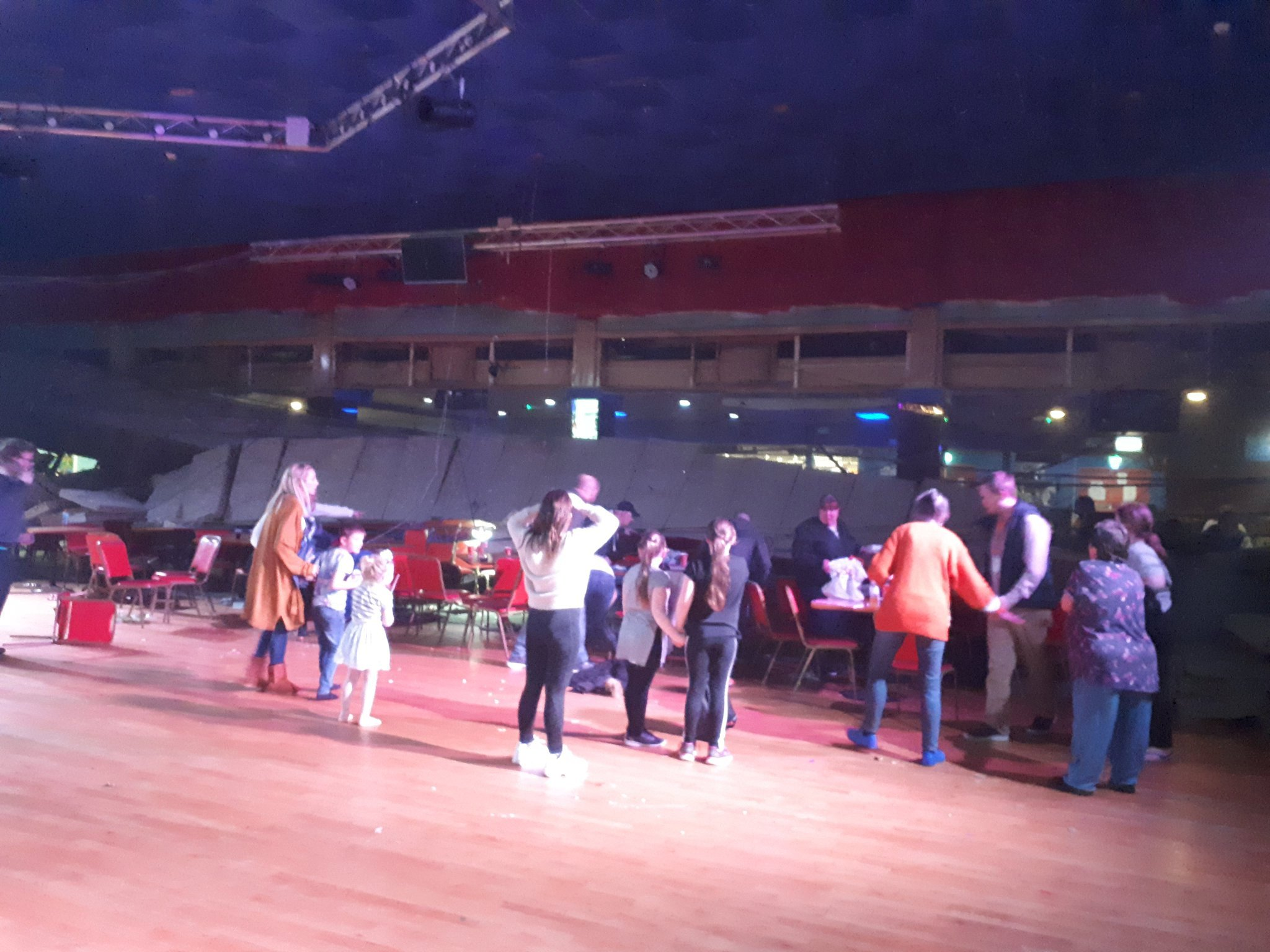 """The scene at Pontins, Brean sands where a ceiling collapsed trapping some guests. See SWNS story SWBRtrapped; People are reportedly trapped after a heating vent collapsed onto a crowd at a busy Pontins resort. Police cars, fire engines and ambulance crews were called after part of the heating system collapsed in the 'fun factory' amusement venue. One witness said that children were trapped underneath the huge structure in the Pontins Brean Sands Holiday Park, in Somerset. The woman reported hearing """"screaming"""" as parts of the roof fell to the floor during a busy half-term break."""