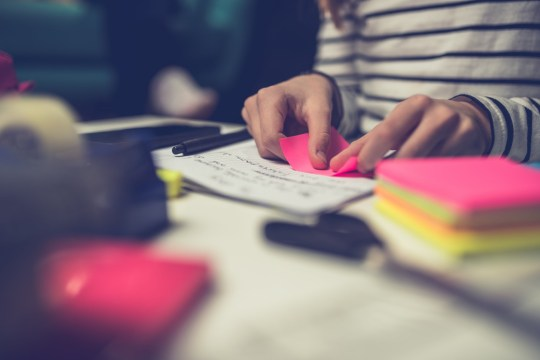 Boy allowed back into school Girl doing homework late at night and peeling off sticky notes