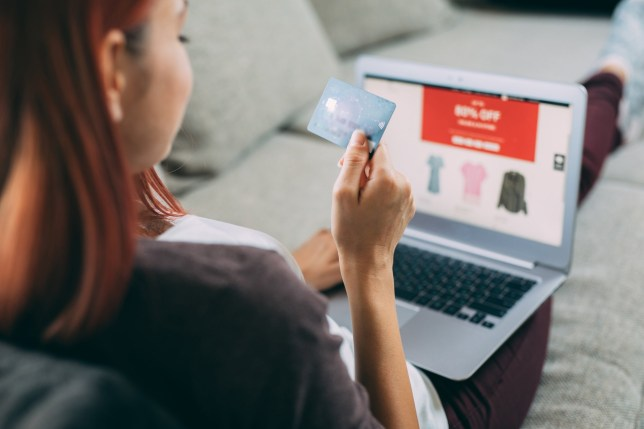 Tax for online shopping Woman making online payment via laptop at home.