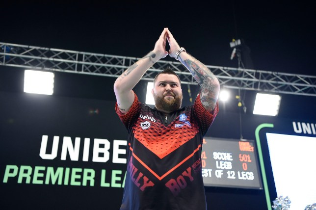 21/2/19: Michael Smith in action against Daryl Gurney in action during the Unibet Premier League Darts match at the 3Arena, Dublin. Picture: Michael Cooper