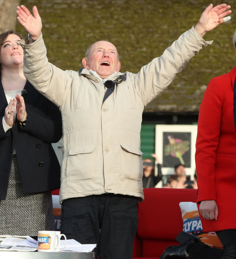 Tony Foulds, 82, waves from Endcliffe Park in Sheffield, as warplanes from Britain and the United States stage a flypast tribute to ten US airmen 75 years after he witnessed the crash that killed them. PRESS ASSOCIATION Photo. Picture date: Friday February 22, 2019. Mr Foulds, has spent much of his life treating a memorial to the airmen whose plane crashed in front of him as he played in Endcliffe Park in Sheffield on February 22 1944. See PA story MEMORIAL Flypast. Photo credit should read: Danny Lawson/PA Wire