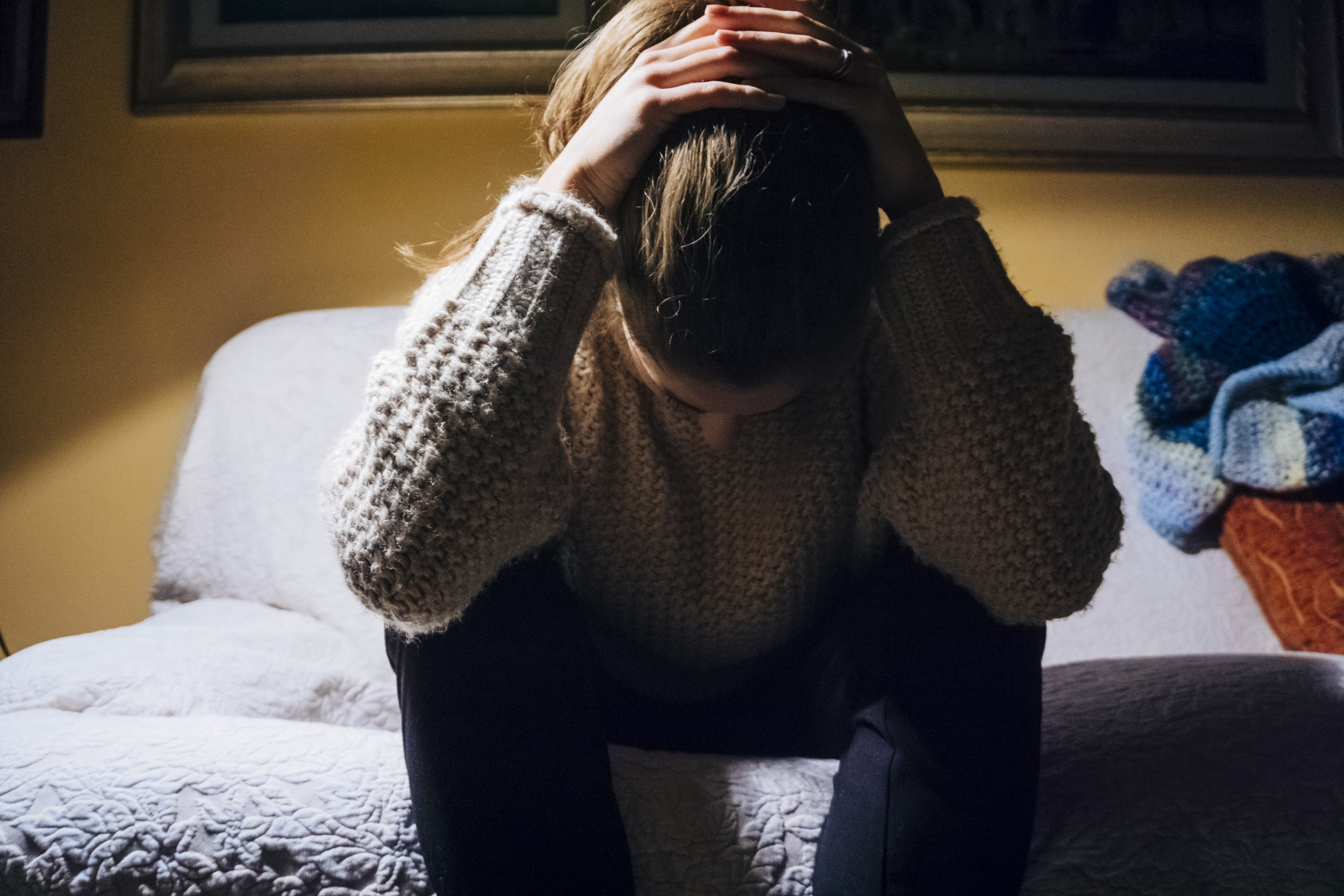 PTSD affects 'one in 13 by age of 18' Young woman suffering from headache