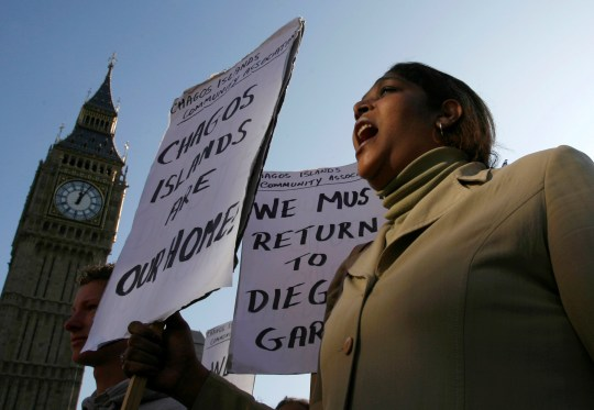 FILE PHOTO: FILE PHOTO: A demonstrator demanding her return to the Chagos Islands in the Diego Garcia archipelago shouts during a protest outside the Houses of Parliament in London October 22, 2008. REUTERS/Andrew Winning/File Photo/File Photo