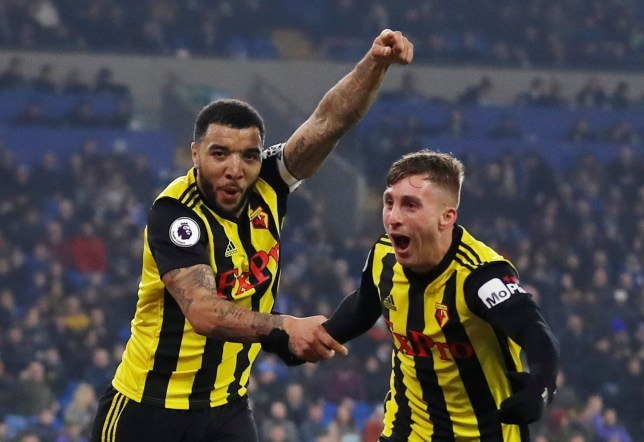 """Soccer Football - Premier League - Cardiff City v Watford - Cardiff City Stadium, Cardiff, Britain - February 22, 2019 Watford's Troy Deeney celebrates scoring their fourth goal with Gerard Deulofeu Action Images via Reuters/Matthew Childs EDITORIAL USE ONLY. No use with unauthorized audio, video, data, fixture lists, club/league logos or """"live"""" services. Online in-match use limited to 75 images, no video emulation. No use in betting, games or single club/league/player publications. Please contact your account representative for further details."""