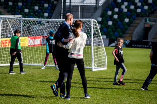 The Duke and Duchess of Cambridge playing football with young children during their visit to Windsor Park, Belfast as part of their two day visit to Northern Ireland. PRESS ASSOCIATION Photo. Picture date: Wednesday February 27, 2019. The royal pair learnt more about the IFA's community Football projects, and how sport can play a role in bringing communities together. See PA story ROYAL Cambridge. Photo credit should read: Liam McBurney/PA Wire