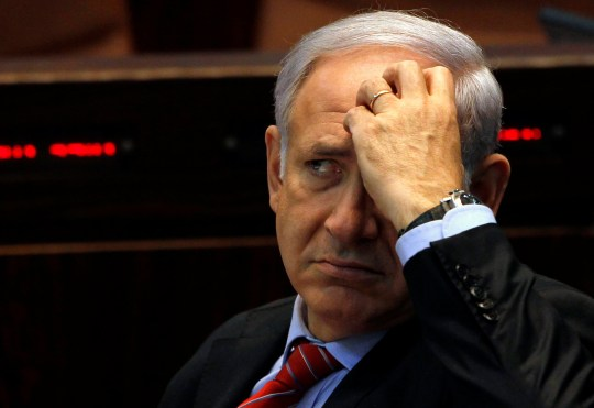 FILE PHOTO: Israel's Prime Minister Benjamin Netanyahu attends a session of the Knesset, the Israeli parliament, in Jerusalem November 3, 2010. REUTERS/Ammar Awad/File Photo