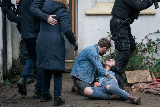 David cradles Shona after a Coronation Street stabbing