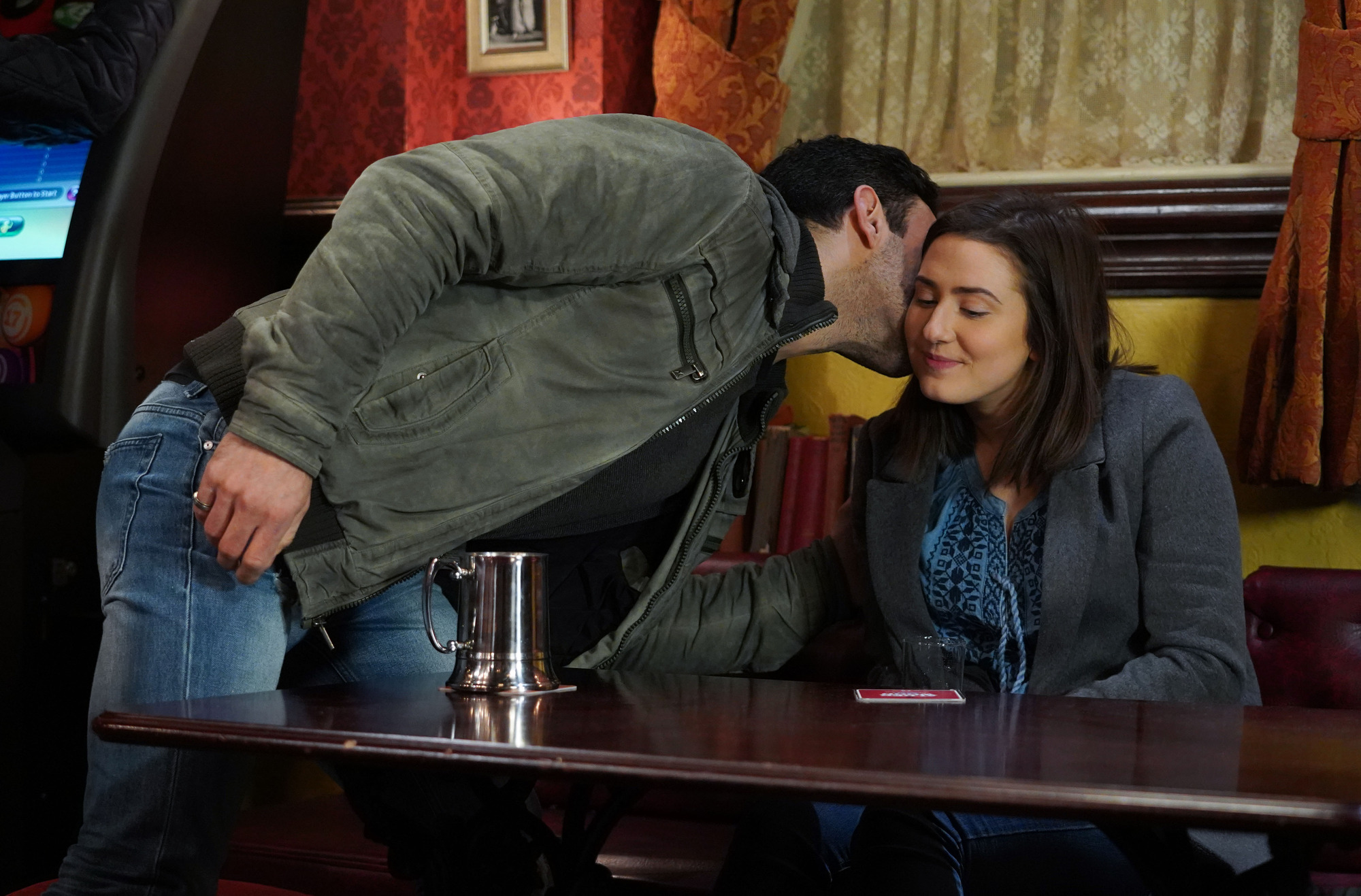 What is the age difference between Kush and Bex in EastEnders as their relationship heats up?