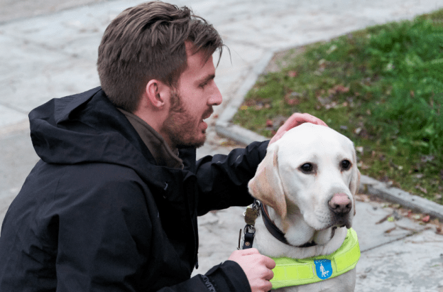 Alex Pepper with his guide dog, River