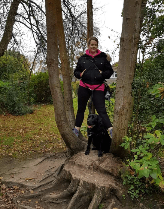 Charlotte Smith, who is profoundly deaf, with her assistance dog