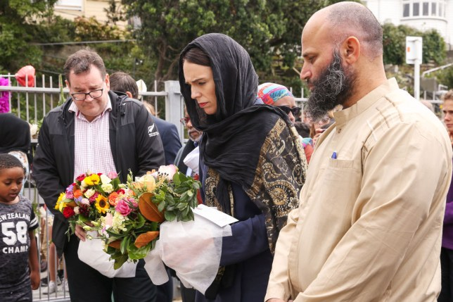 Jacinda Ardern lays flowers at mosque