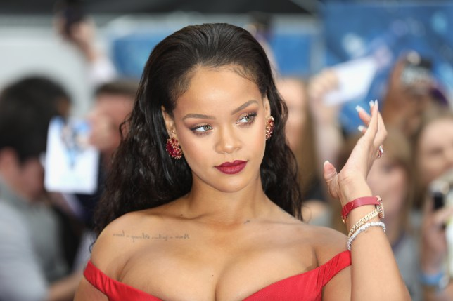 Rihanna pictured wearing a red dress