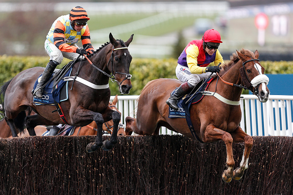 Richard Johnson riding Native River clear the second fence before going on to win The Timico Cheltenham Gold Cup Steeple Chase from Might Bite at Cheltenham