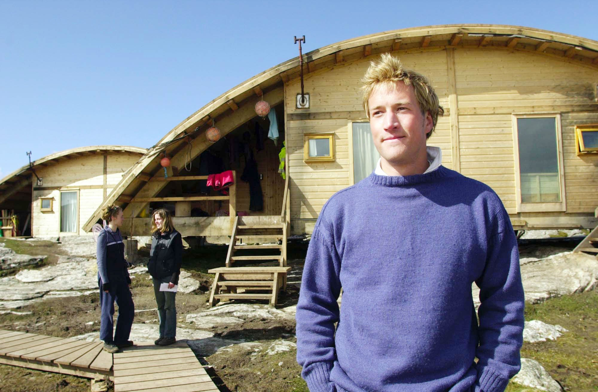 Castaway Benjamin Fogle (Ben Fogle), one of the 35 adventurers, who are being filmed for the BBC fly on the wall show, Castaway 2000, looks out from the 'pod' living accommodation as Philly Page (left) chats to Tanya Cheadle on the island of Taransay in the Western Isles of Scotland Friday 14th April 2000, where the group have been living since New Year's Eve as part of the BBC's television programme. See PA Story MEDIA Castaway. **EDI** PA Photo: Ben Curtis....A